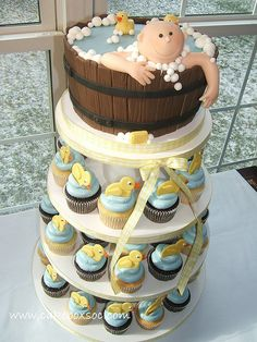 Baby shower cake and cupcakes.  Rubber ducks theme.