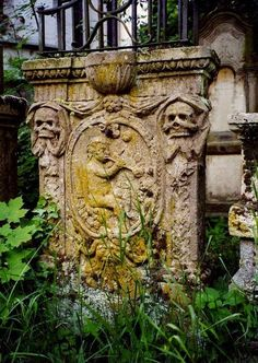 A tomb showing a child blowing bubbles other iconography. St. Peter's cemetery in Straubing, Germany; the Basilica was built around 1250 CE.