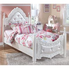 With the exquisite beauty of formal French style brought to life within a country motif, the Exquisite Youth Bedroom Collection by Signature Design by Ashley Furniture is sure to create a sense of magic and wonder to any child's bedroom. With a luminous replicated white paint finish flowing smoothly over the decorative embossing and beautifully turned detailing, this furniture is perfectly designed for any little girl's room. The satin nickel color hardware and stylish appliqués and rosettes…