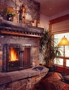 Fireplace. Massive stone, massive wood; perfect compatability.