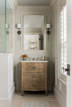 """The vanity is the """"Empire Rosette Single Vanity Sink Base"""" - from Restoration Hardware."""