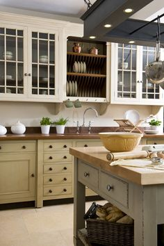 I like the lower cabinets. I especially like that the uppers and lowers are two different colors. Somehow the whole combination gives it a potting shed sort of feel... a kitchen garden sort of kitchen... interesting idea for inside the house. Especially for beside the study...