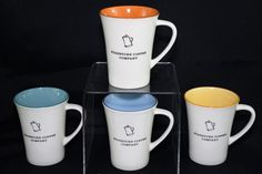 Starbucks Coffee Company. We will be listing several Starbucks mugs so be sure to follow our store. Kettle/Coffee Pot on front. White with Green, Blue, Orange and Yellow inside. Nice Matching set.