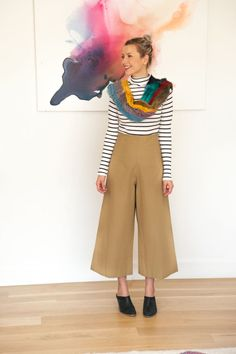 Cropped pants and a striped top paired with a fun scarf for the winter weather!