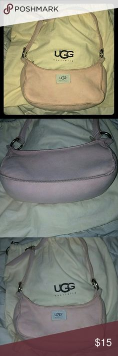*Light Pink UGG Purse* w/dust bag This is a vintage early-mid 2000's pink Ugg purse. It was recently cleaned and most of ot looks good. The place where the adjustable strap meets the purse has some wear which I attempted to get in the pictures. There's one dark spot in the bottom of the fluffy soft inside. Oh and there are a couple small holes in the dust bag. But it is newly cleaned!  I tried to get all the little flaws in the pics. If you have ANY QUESTIONS about the bags condition PLEASE…