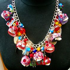 A Frida Kahlo / Day of The Dead necklace with hand carved porcelain skulls and Swarovski crystals - by Leandra Holder on Etsy