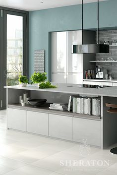 Modern handle less kitchen in gloss grey with large island unit incorporating open shelving - perfect for all those cook books! For more Sheraton kitchens, please see http://www.sheratonkitchens.co.uk/kitchens