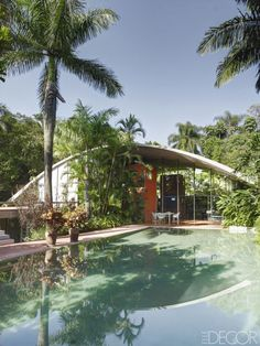 In architect Marcos Ayacaba's modern retreat in Brazil, the roof, pool, and stairs are all made of concrete, and the surrounding gardens were designed by Marlene Acayaba.