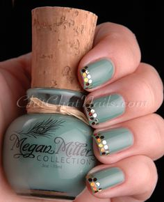 jelly based jewel toned teal with placed glitter accents on tips nail art design