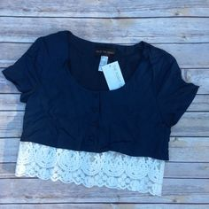 """Navy & Lace Crop Top New with tags navy blue and lace crop top. Front buttons, scoop neck. Size Small. Bust 36"""", length 17"""", shoulder to shoulder 16"""". No trades, offers welcome. Tops Crop Tops"""