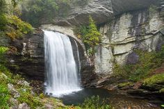 Looking Glass Falls in the Pisgah National Forest is said to be the second most photographed waterfall in the US after Niagara Falls. This gorgeous waterfall is very accessible as it is located directly on US Hiking Places, Hiking Spots, Bryson City North Carolina, Carolina Pride, The Places Youll Go, Places To See, Pisgah Forest, Lake Lure, Ga In