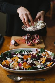 pretty winter salad w/ kale, beets, oranges, apples, pomegranate, cabbage and feta