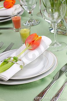 Pretty orange and green table setting with tulip.