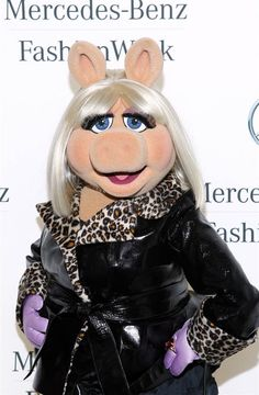 Even Miss Piggy of The Muppets showed some fashion know-how in a leather trench coat at the Mercedes-Benz star lounge during Spring 2013 Mercedes-Benz Fashion Week. (Photo: Paul Morigi / Getty Images Contributor)