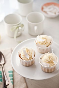 Gluten Free Lemon Coconut Cupcakes -  INGREDIENTS - 2 large eggs  1/2 cup granulated sugar  3/4 cup olive oil (don't skimp on the quality)  1 cup plain yogurt (low or full fat)  zest and juice of a lemon  1 cup rice flour  1/2 cup millet flour  1/2 cup desiccated coconut  1 tablespoon baking powder  pinch of salt  shaved coconut to decorate (optional)