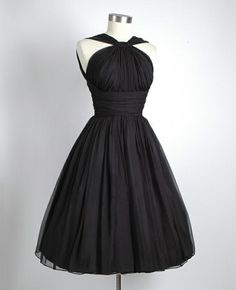 sleeveless black dress with midriff yoke and full flared skirt