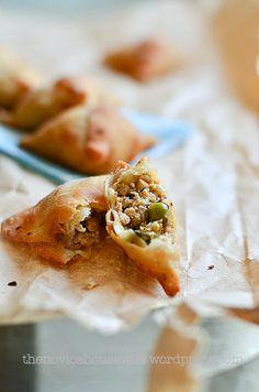 Chicken samosa: savory pastry dough filled with indian spiced chicken filling that is then baked.