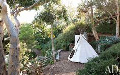 so fun for the kiddos The tepee in the terraced garden is by Earthworks.  Read more: http://www.architecturaldigest.com/homes/homes/2011/03/good_vibrations_slideshow#ixzz1kVW6fUTs
