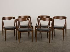 Set Six Teak Armchairs, Leather Seats, Denmark c.1965 made by Soborg Mobelfabrik. The elegant curves that comprise the back and arms of these chairs give a seamless line that is quintessentially mid century modern in appearance. The beautifully polished timber contrasts nicely with the leather seat both in colour and texture and the slight slant of the seat ensures comfort when seated around a table as the horizontal back provides exceptional support. The design of the chairs is most…