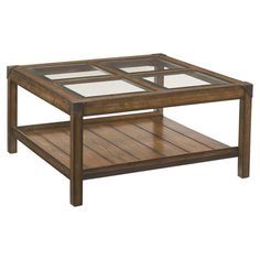 A handsome addition to your living room or den, this rustic-chic coffee table showcases a bottom display shelf, 4 beveled glass panels, and a timeless oak fi...