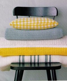 stacked linens on a chair for guest bedroom