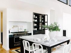 Black kitchen cabinets are perfect for showing off a collection of white ceramics!