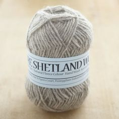 Soft and fine wool from Shetland sheep comes in many colours, here in grey double knitting yarn