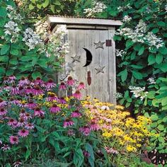 An old outhouse, bought at a fair flea market, serves as both a storage shed and a decorative object in this yard.    Photo: Linda Oyama Bryan   thisoldhouse.com