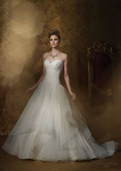 Tulle is one of the biggest trends in the 2015 bridal market! If you are a fan, we've got you covered with this James Clifford Strapless corded lace and tulle ball gown! #silkbride #Jamesclifford #tulle #lace