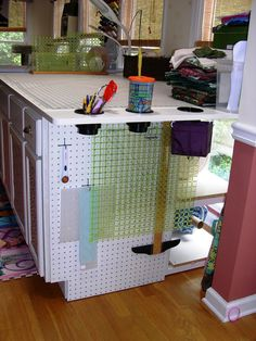 View from the right. More pegboard with large ruler storage and quilting templates.