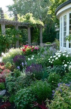 use a pergola for height to help create a lush garden...