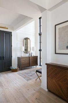 A welcoming front entry with, black doors, bench, wall sconces, wall panel detai. - My House - Architecture Country House Interior, Home Interior Design, Black Doors, Black Interior Doors, Interior Walls, Floor To Ceiling Windows, Front Entry, Front Hallway, Entry Doors