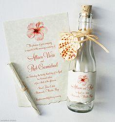 Tropical bottle invitations with hibiscus watercolor art | www.mospensstudio.com