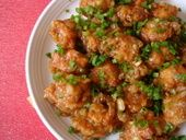 A party appetizer that is loved by all at my home. After a couple of trials, I have settled with this recipe. The secret to a flavorful Chicken Manchurian is the use of chicken stock. Marinated boneless chicken is deep fried and the golden balls are tossed with a cor