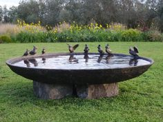 Birdbath -- could be made with a large heavy bowl found at Homegoods, and two large stones from the backyard