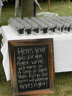 I really like this an idea for a wedding favor. Love the fact even more it looks like chalkboard paint on the glasses.