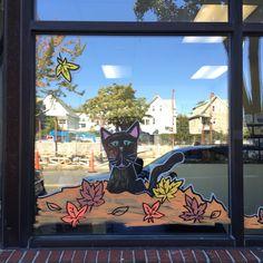 Black cat window painting, Union Square Veterinary Clinic.