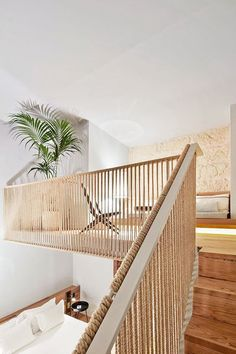 modern mezzanine room design with hemp rope railing, wooden interior staircase, limestone wall and w Rope Railing, Staircase Railings, Interior Staircase, Stair Makeover, Beautiful Stairs, Hotel Apartment, Stair Storage, House Stairs, House Design