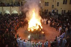Iraqi Christians gather around a fire to celebrate Christmas in a church in Hamdaniya town in northwest Baghdad.