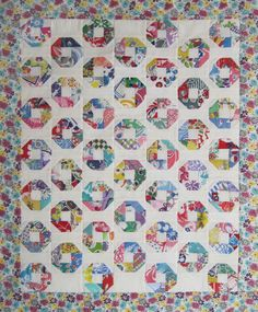 The only place I could find this pattern is on the first page of Maggie Malone's 5,000 Quilt Block Designs.  She calls it Big O, but the name doesn't have a reference to any publication.  I thought I should change the name for this little quilt. The pattern reminds me of Kansas Dugout (here is mine -- also made with feedsacks), but Kansas Dugout has many set-in pieces and is usually hand sewn.  Little O is pretty simple to sew on the machine, even in this reduced size, because you on...