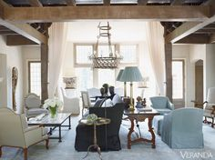 Designer Susan Ferrier made the double-height living room of this Mountain Brook, Alabama, home feel more intimate by creating a variety of seating arrangements.   - Veranda.com