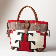 "Timpanogos Travel Bag Our serape-striped wool bag, big enough for a weekend, has a wool fabric bottom, handles and buckled closure, . Nylon lining with two full-length zip pockets. Made in the USA. 19""W x 6""D x 13""H. $248"