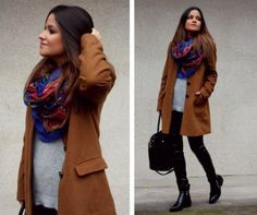leather pants, long brown coat and colorful scarf