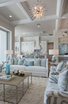 Light blue & white home decor with different patterns and textures create a calm and serene mood in this stunning living room.