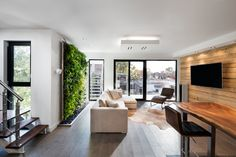Salon avec mur végétal