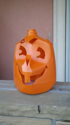 Create pumpkins from gal milk jugs and a can of orange spray paint. Shannon