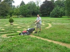 Simon Akeroyd mowing the Wisley grass maze on Seven Acres lawn