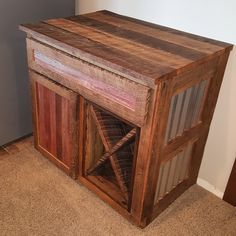 Built out of reclaimed oak and pine with corrugated metal on the sides. Used Danish oil to seal it.