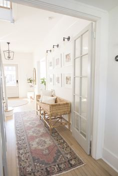Hallway with french doors. Light French Grey with Pure white walls. Rattan bench under family gallery wall Luxury Homes Interior, Interior Design, Interior Colors, Light Oak Floors, White Oak Floors, Apartment Interior, Diy Home, Home Decor Accessories, Style At Home