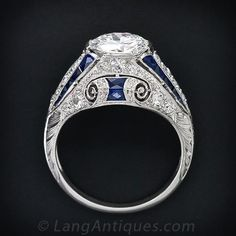 Few, if any, come finer or more beautiful than this original and exemplary Art Deco diamond ring, masterfully and artfully handcrafted in platinum, diamonds and calibre sapphires - circa This ring highlights a bright-white and shining European-cut d Art Deco Diamond Rings, Art Deco Ring, Art Deco Jewelry, Fine Jewelry, Jewelry Design, Diamond Art, Diamond Brooch, Antique Jewelry, Vintage Jewelry